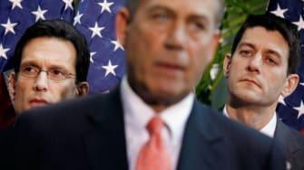 House Majority Leader Eric Cantor and House Budget Committee Chairman Paul Ryan listen to Speaker of the House John Boehner.