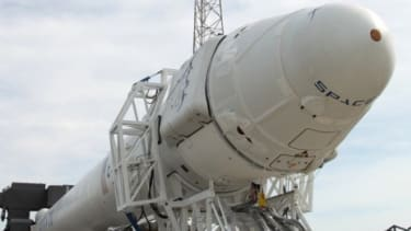 The Dragon spacecraft and its Falcon 9 rocket are rolled to the Cape Canaveral, Fla., launch pad for tests ahead of the landmark liftoff May 19.