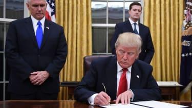 Trump signs.