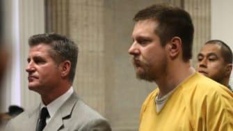 Former Chicago police Officer Jason Van Dyke and his attorney Daniel Herbert attend Van Dyke's sentencing hearing.