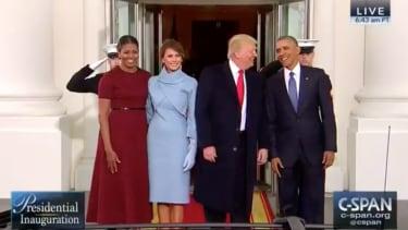 Obamas greet Trumps at White House.