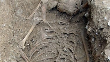 Archaeologists unearth skeleton of girl thought to be a witch