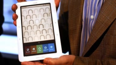 With Microsoft as its partner, Barnes & Noble may make a run at Amazon's Kindle Fire by upgrading its Nook to a Windows 8 operating system.