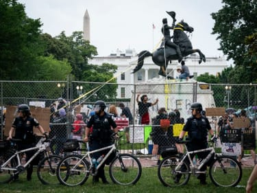 People try to tear down a statue of Andrew Jackson.