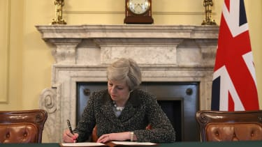 British Prime Minister Theresa May signs a letter invoking Article 50