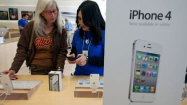 A customer considers an iPhone purchase
