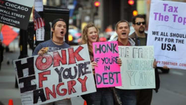 Protesters in Chicago jump on the Occupy Wall Street bandwagon, which has spread to a number of cities since it began in New York three weeks ago.