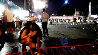 Concertgoers try to find safety.