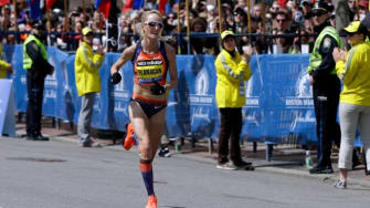 American long-distance runner Shalane Flanagan approaches the finish line, taking fourth in the women's division of the Boston Marathon on April 15.