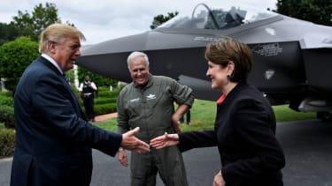 Lockheed Martin CEO Marillyn Hewson shakes hands with President Trump.