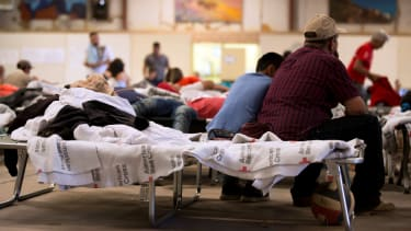 Migrants in a shelter at the Southwestern New Mexico State Fairgrounds.