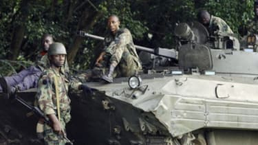 Forces loyal to Ivory Coast's president-elect Alassane Ouattara rest on Saturday, before battling forces aligned with former president Laurent Gbagbo.