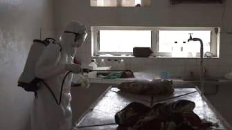 A health worker sprays down a hospital in Sierra Leone, during 2014's devastating Ebola outbreak