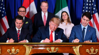 Mexico's President Enrique Pena Nieto (L) US President Donald Trump (C) and Canadian Prime Minister Justin Trudeau, sign a new free trade agreement in Buenos Aires, on November 30, 2018