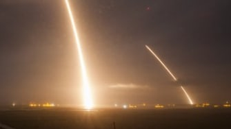 A long exposure of the launch and re-landing burns of the Falcon 9 rocket.