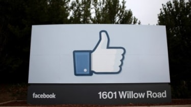 """The Facebook """"like"""" symbol at the company's headquarters in Menlo Park, Calif.: The social network is reportedly testing a new button that would appear on websites for retailers like Pottery"""