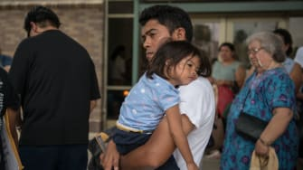 A migrant child and her father.