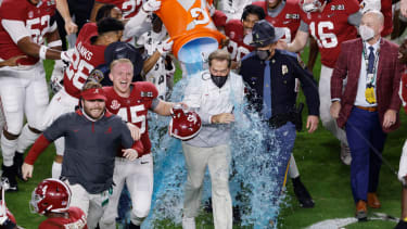 Nick Saban is dunked after record seventh national title
