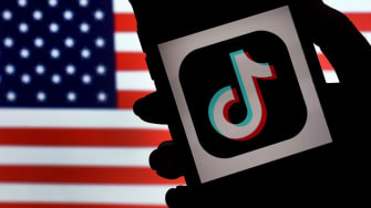 In this photo illustration, the social media application logo, TikTok is displayed on the screen of an iPhone on an American flag background on August 3, 2020 in Arlington, Virginia.