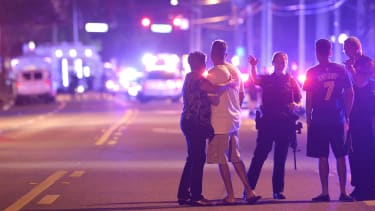 Family members wait for information after Sunday's massacre in Orlando.