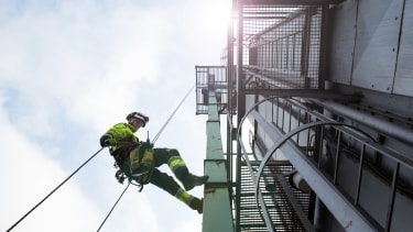 Man working from tower.