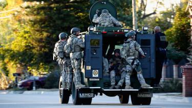 A SWAT team patrols patrols an area of San Bernardino.