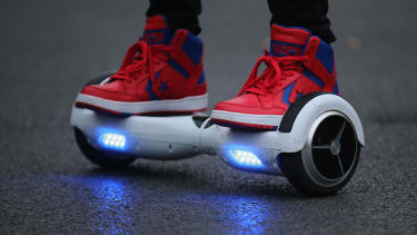 A teenager on a hoverboard.