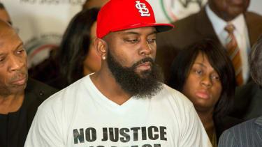 Michael Brown grand juror sues prosecutor over gag order