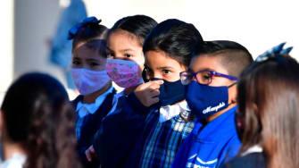 Kids wear masks to school in Los Angeles.
