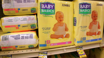 Baby diapers on a store shelf.