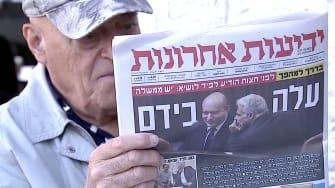 Israeli newspaper reader