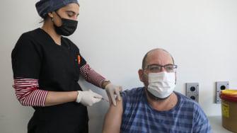 Man receives Pfizer vaccine