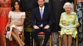 Prince Harry, Meghan Markle, and Queen Elizabeth II.