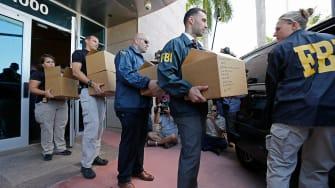 FBI agents execute warrant