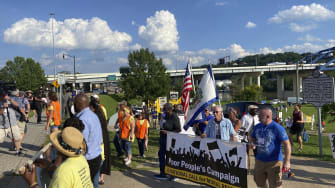 Protesters marching against Sen. Joe Manchin.