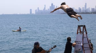 Dan O'Conor jumps into Lake Michigan.