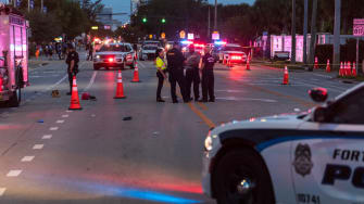 Police investigate the scene where a pickup truck drove into a crowd of people at a Pride parade on June 19, 2021 in Wilton Manors, Florida.