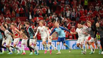 Denmark football team celebrates win over Russia.