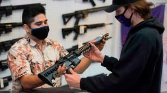 A customer looks at a customized AR-15.