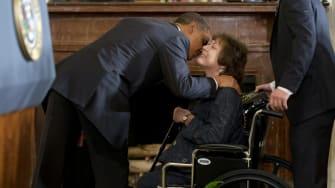 Barack Obama greets Natoma Canfield.