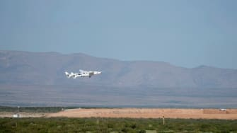 Virgin Galactic's VMS Eve carries the VSS Unity on takeoff from Spaceport America