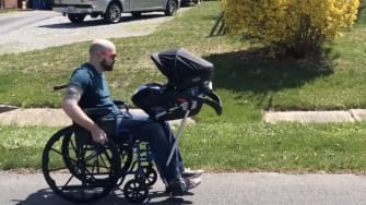 Jeremy King on a stroll with his infant son.