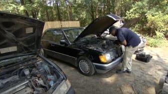 Eliot Middleton works on repairing an old car.