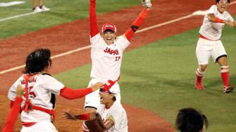 Japanese softball team celebrates gold medal.