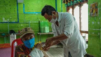 A man in Bhutan receives a COVID-19 vaccine.