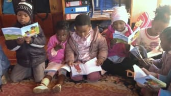 South African children read their books from Book Dash.