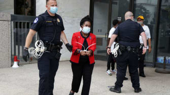 Rep. Sheila Jackson Lee is arrested on Thursday at a voter rights protest.