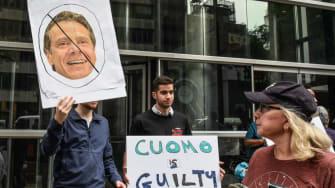 Protestors denounce Cuomo.