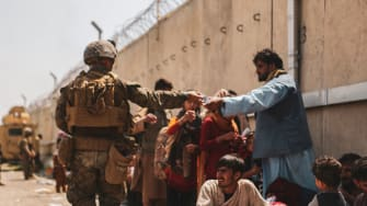 U.S. Marine hands out water at Kabul airport