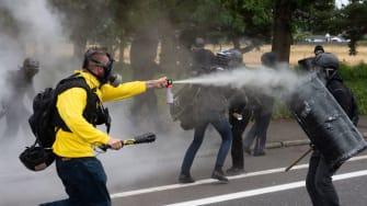 Demonstrators clash in Portland on Sunday.